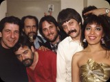 Leonard's band from '85.  L to R:  Leonard Cohen, Richard Crooks (drums), John Crowder (bass and vocals), Mitch Watkins (guitar and vocals), Ron Getman (guitar and vocals), Anjani (keys and vocals)