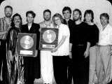 "Jennifer Warnes wins a gold record for ""Famous Blue Raincoat"""